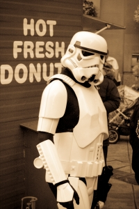 "Stormtrooper in front of a sign for ""Hot Fresh Donuts"""