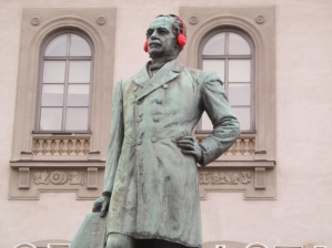 Statue wearing headphones